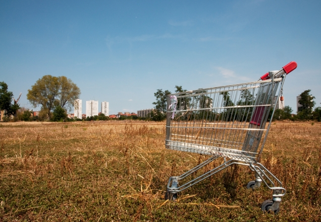 Broken shopping cart in the nature